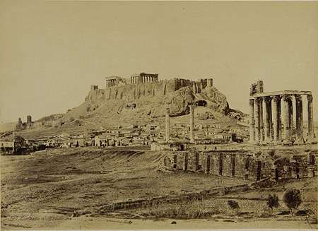 The temple of Olympian Zeus with the Acropolis in the background. The cloister of a colonnade and a café are visible in the archaeological site. Athens, c. 1865 · Dimitrios Konstantinou · © Benaki Museum Photographic Archive